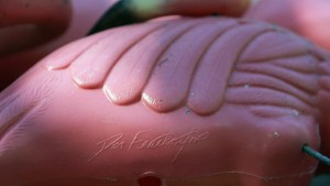 Key Biscayne, UNITED STATES: The signature of Don Featherstone is seen on the bottom of a plastic pink flamingo on display in the yard of Paige Sonnabend 25 October 2006, in Key Biscayne, Florida. The pop-culture symbol met its demise after its manufacturer, Union Products, of Leominster, Massachusetts was socked with a triple economic threat ? increases in costs of electricity and plastic resin combined with loss of financing. Production of the original Don Featherstone pink flamingo ended in June, and the plant is scheduled to close 01 November according to president and CEO Dennis Plante. Union Products made 250,000 of its patented plastic pink flamingos a year in addition to other garden products. Featherstone, the retired president of Union Products, designed the colorful birds. AFP PHOTO/Robert SULLIVAN (Photo credit should read ROBERT SULLIVAN/AFP/Getty Images)